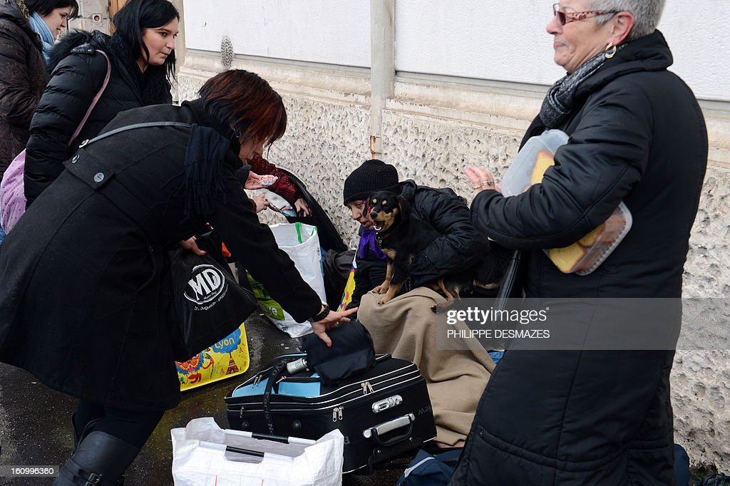 MOUTTET --- Pascale Madeleine and four other 'marauders' distribute blankets, biscuits and soup to the homeless in the streets of Lyon on February 6, 2013. Most citizens' initiatives solicit admiration, but outings like this intended only for the 'native French' by extreme right-wing groups is creating a debate.