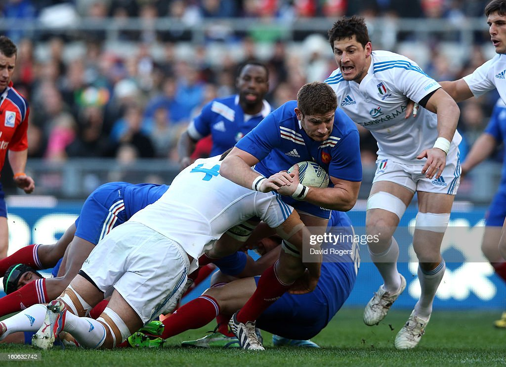 Pascale Pape of France is tackled by Quintin Geldenhuys during the RBS Six Nations match between Italy and France at Stadio Olimpico on February 3, 2013 in Rome, Italy.
