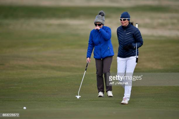 Pascale Reinhard and Janet Siehnthiler from Switzerland play a round of golf at Muirfield Golf Club on March 14 2017 in Gullane Scotland Muirfield...
