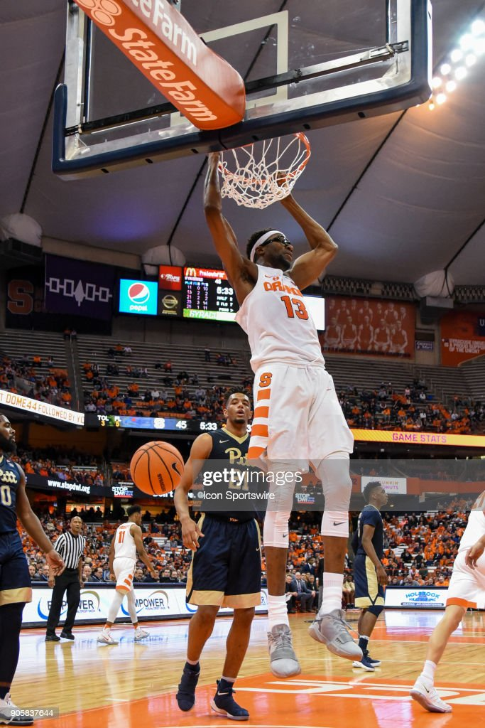 Paschal Chukwu #13 of the Syracuse Orange dunks the ball during the second half of play between the Syracuse Orange and the Pittsburgh Panthers on January 16th, 2018 at the Carrier Dome in Syracuse, NY.