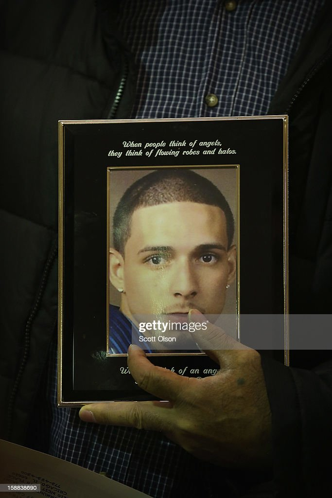 Pascual Nunez holds a picture of his stepson Harry Rodriguez during a press conference he attended with other family members of murder victims on December 31, 2012 in Chicago, Illinois. Rodriguez was 23-years-old when he was shot to death on October 23, 2011.