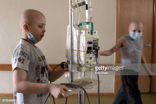 Pasha from the city of Baranovichi and Vova Kazakhstan walk down the hallway of the Children's Oncology Center on March 13 2006 in Minsk Belarus Both...