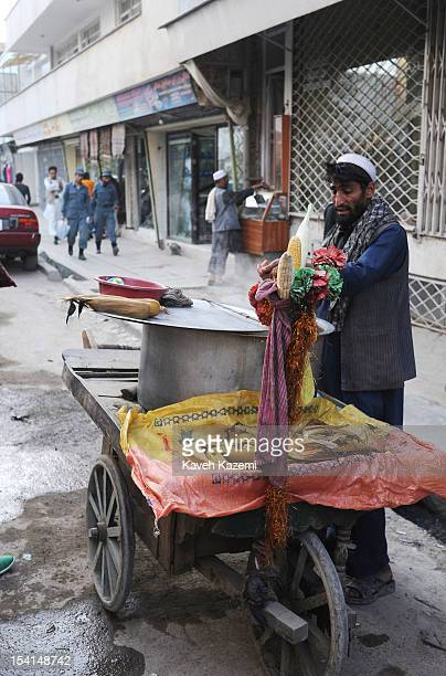 Pashtoon Afghan street vendor selling steamed corn seen in front of his push cart in Chicken Street on October 17 2011 in Kabul Afghanistan Chicken...