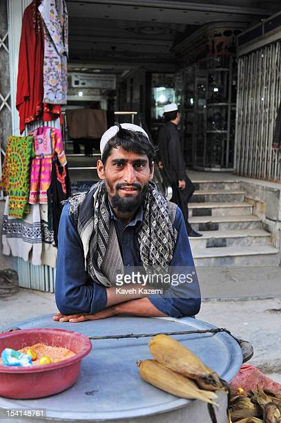 Pashtoon Afghan street vendor selling steamed corn seen in front of his stand in Chicken Street on October 17 2011 in Kabul Afghanistan Chicken...