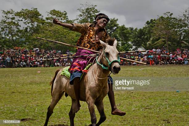Pasola rider reacts after throwing his spear during the pasola war festival at Wainyapu village on March 7 2013 in Sumba Island East Nusa Tenggara...