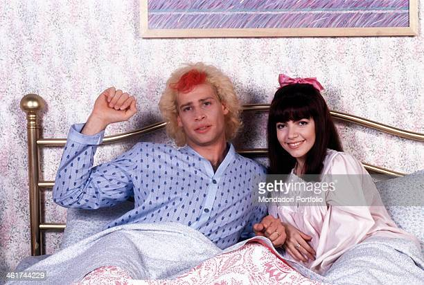 Pasquale Finicelli and Cristina D'Avena taken together in a bed playing in the guises of two sweethearts Mirko and Licia in the TV serial Balliamo e...