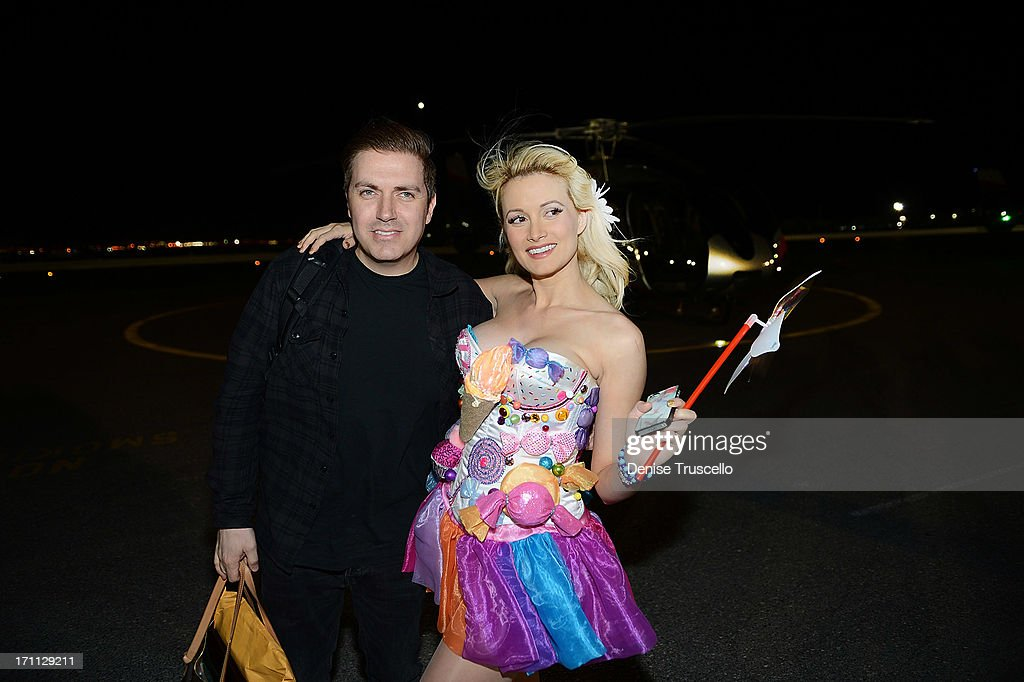 Pasquale Rotella and <a gi-track='captionPersonalityLinkClicked' href=/galleries/search?phrase=Holly+Madison&family=editorial&specificpeople=227275 ng-click='$event.stopPropagation()'>Holly Madison</a> arrive at the 17th annual Electric Daisy Carnival at Las Vegas Motor Speedway on June 21, 2013 in Las Vegas, Nevada.