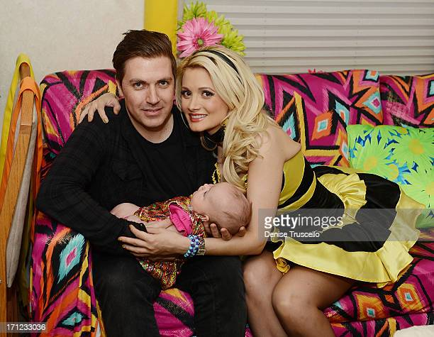 Pasquale Rotella Rainbow Aurora Rotella and Holly Madison pose for a portrait in a quiet room before the 17th annual Electric Daisy Carnival at Las...