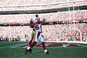 A pass intended for Michael Floyd of the Arizona Cardinals is broken up by Marcus Cromartie of the San Francisco 49ers in the second quarter at...