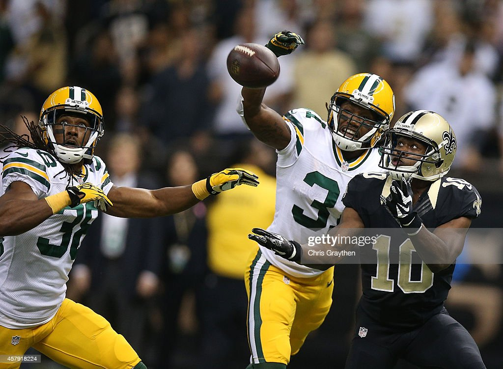 A pass is broken up by Davon House #31 of the Green Bay Packers as Brandin Cooks #10 of the New Orleans Saints tries for the catch during the first quarter at Mercedes-Benz Superdome on October 26, 2014 in New Orleans, Louisiana.