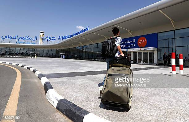 A passanger arrives at the newly opened AlMaktoum International airport in Dubai October 27 2013 The new passenger terminal opened its doors for...