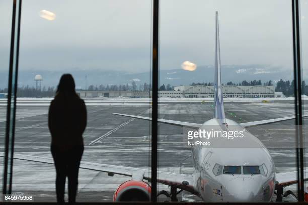 A passanger is looking through the window at Gardermoen Oslo Airport On Monday February 27 Oslo Norway
