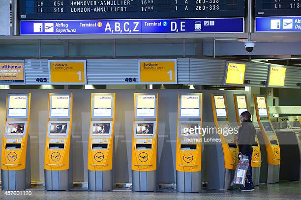 A passanger pass try to get a boarding pass at the Frankfurt Airport on October 21 2014 in Frankfurt am Main Germany Vereinigung Cockpit the labor...