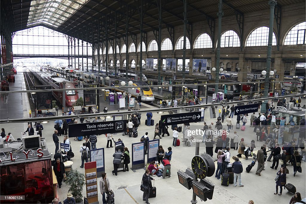 Passangers and trains in Gare du Nord station,