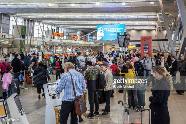 Passangers at Sydney Airport face a long wait to clear security on July 31 2017 in Sydney Australia Counter terrorism police raided four houses...