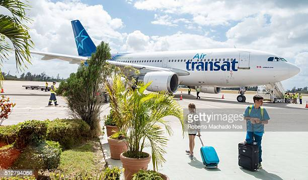 Passangers getting ready to board the Air Transat airplane about to departure Cuba waiting on passengers to board the aircraft for safety instruction...