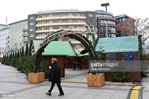 A passant walks at the entrance of the Chritsmas market in Ludwigshafen western Germany on December 16 2016 German prosecutors said Friday they were...