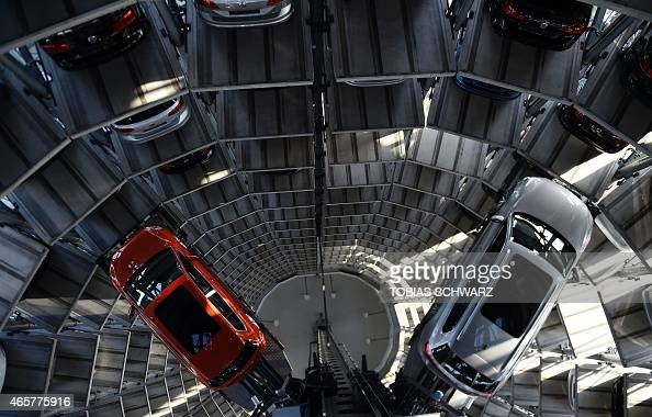 Passat and a VW Golf are pictured inside the socalled cat towers of car manufacturer Volkswagen AG at the company's assembly plant in Wolfsburg March...