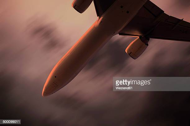 Passenger aircraft during thunderstorm in the evening