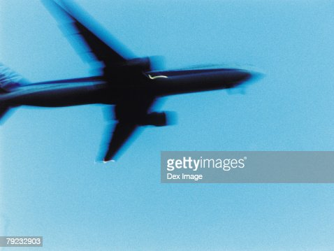 Passenger aircraft flying, elevated view : Stock Photo