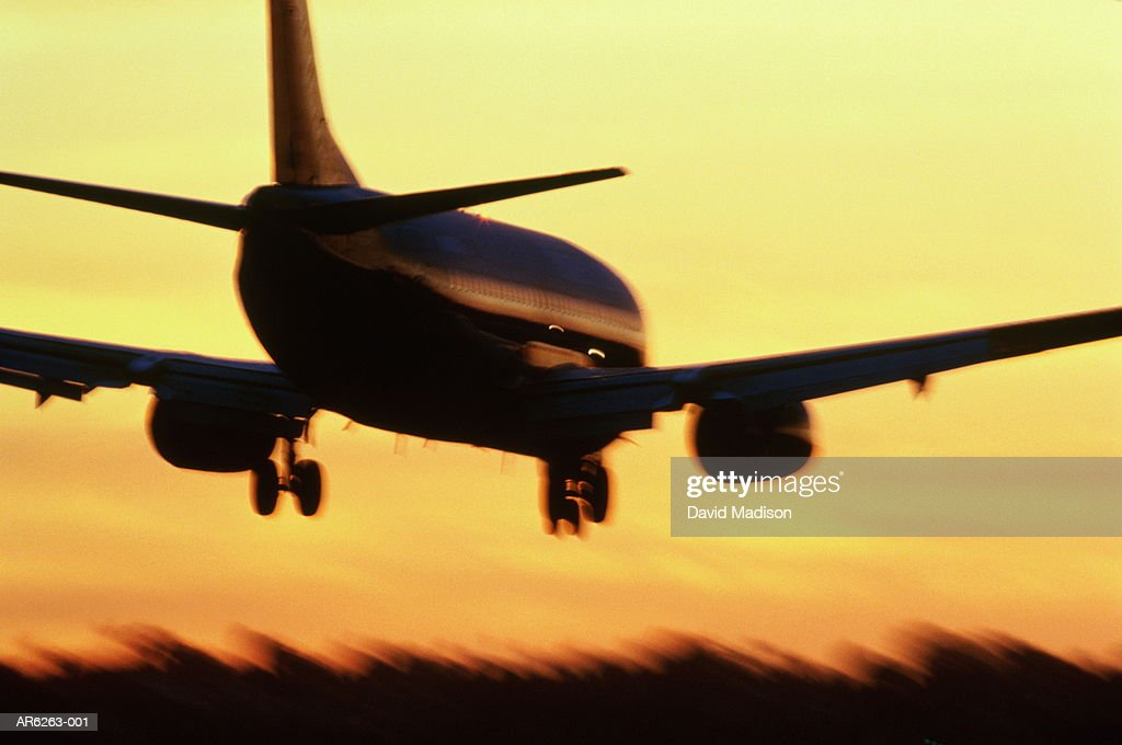 Passenger aircraft in flight at sunset (blurred motion)
