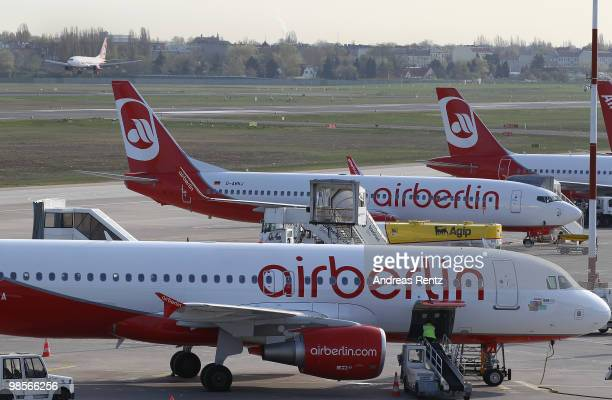 A passenger aircraft of Air Berlin Airlines arrives as other aircrafts get prepared for takeoff at Tegel Airport on April 20 2010 in Berlin Germany...