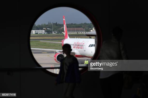 A passenger aircraft operated by Air Berlin Plc sits on the tarmac at Tegel airport in Berlin Germany on Wednesday Aug 16 2017 Air Berlin filed for...