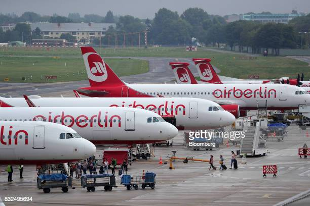 Passenger aircraft operated by Air Berlin Plc stand on the tarmac at Tegel airport in Berlin Germany on Wednesday Aug 16 2017 Air Berlin filed for...