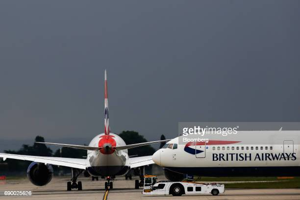 Passenger aircraft operated by British Airways a unit of International Consolidated Airlines Group SA taxi on the tarmac at London Heathrow Airport...