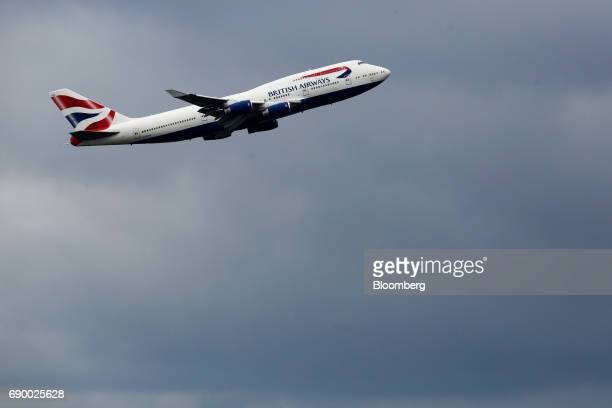 A passenger aircraft operated by British Airways a unit of International Consolidated Airlines Group SA takes off from London Heathrow Airport in...