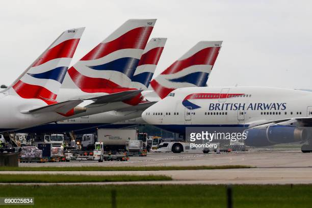 A passenger aircraft operated by British Airways a unit of International Consolidated Airlines Group SA taxis on the tarmac at London Heathrow...