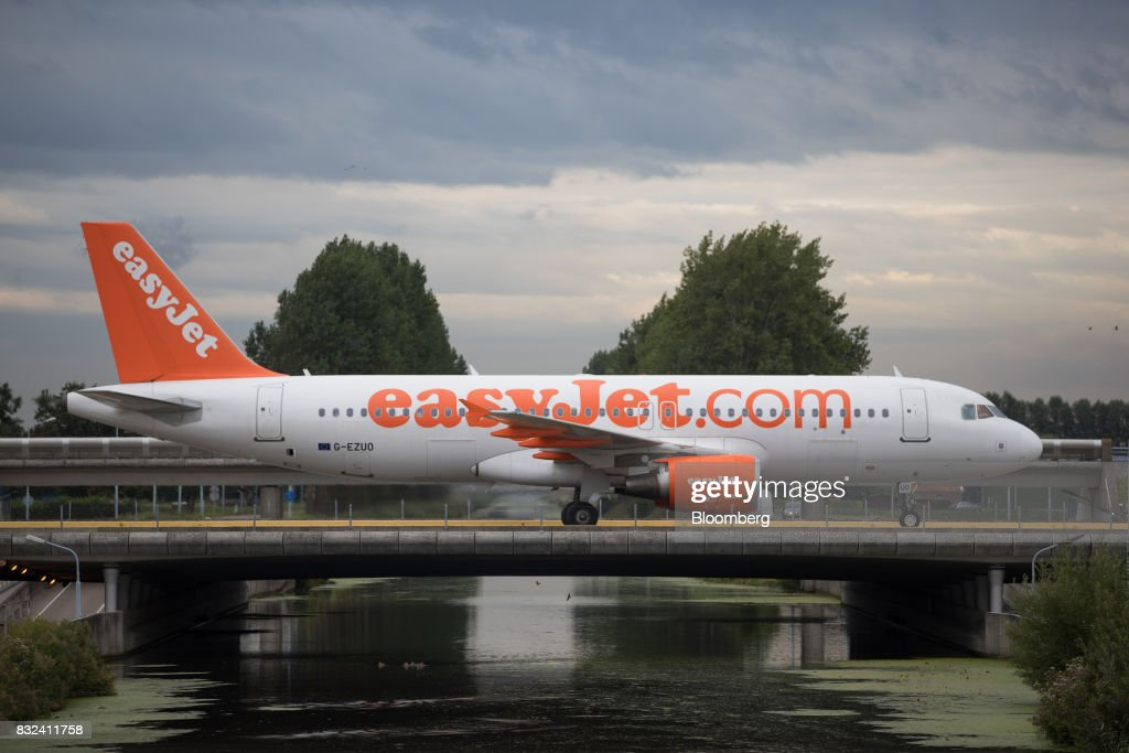 A passenger aircraft operated by EasyJet Plc crosses a bridge after landing at Schiphol airport in Amsterdam, Netherlands, on Tuesday, Aug. 15, 2017. Delta Air Lines Inc., China Eastern Airlines Corp. and Air France-KLM Group are reaching for their checkbooks to forge a deeper global alliance. Photographer: Jasper Juinen/Bloomberg via Getty Images