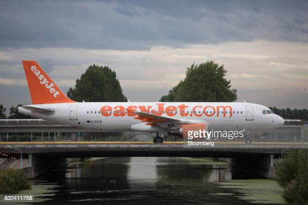 A passenger aircraft operated by EasyJet Plc crosses a bridge after landing at Schiphol airport in Amsterdam Netherlands on Tuesday Aug 15 2017 Delta...