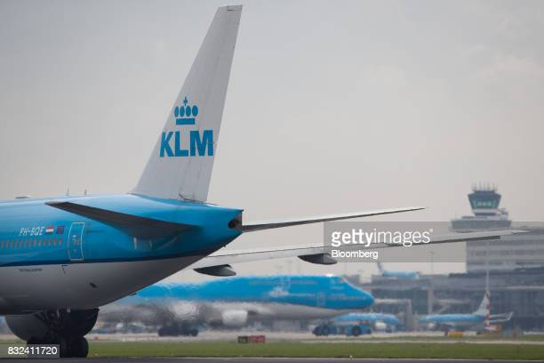 Passenger aircraft operated by KLM the Dutch arm of Air FranceKLM Group stand on the tarmac at Schiphol airport in Amsterdam Netherlands on Tuesday...