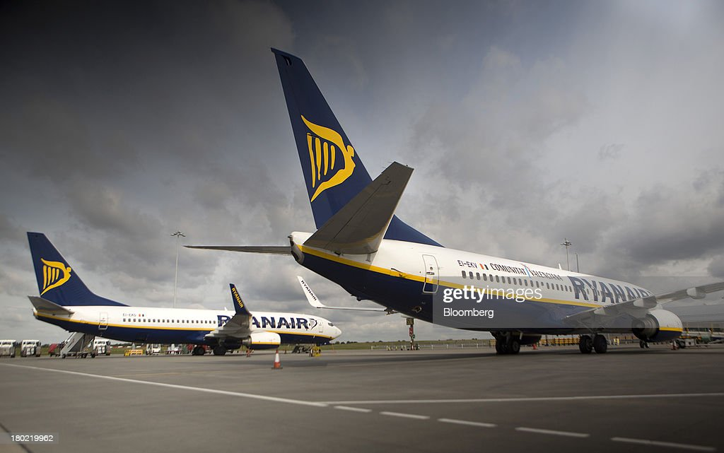 Passenger aircraft operated by Ryanair Holdings Plc are seen on the tarmac at Stansted Airport, operated by Manchester Airports Group (MAG) in Stansted, U.K., on Tuesday, Sept. 10, 2013. From two planes in 1995, EasyJet has grown to more than 200 Airbus SAS aircraft carrying more than 59 million people annually, 20 million fewer than Ryanair. Photographer: Simon Dawson/Bloomberg via Getty Images
