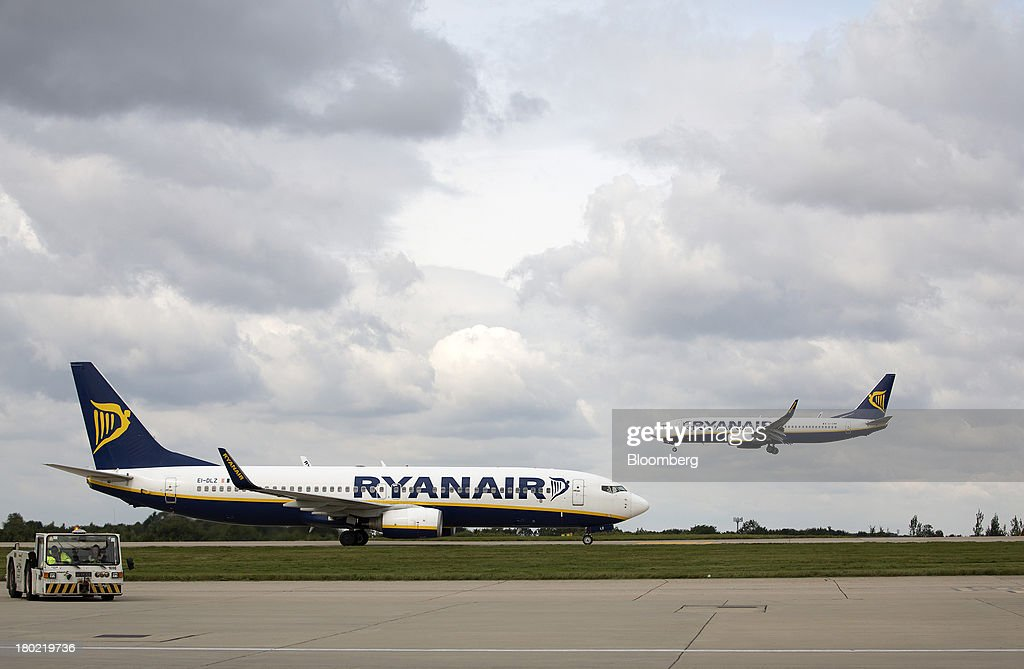 A passenger aircraft operated by Ryanair Holdings Plc comes into land as another departs from Stansted Airport, operated by Manchester Airports Group (MAG) in Stansted, U.K., on Tuesday, Sept. 10, 2013. From two planes in 1995, EasyJet has grown to more than 200 Airbus SAS aircraft carrying more than 59 million people annually, 20 million fewer than Ryanair. Photographer: Simon Dawson/Bloomberg via Getty Images