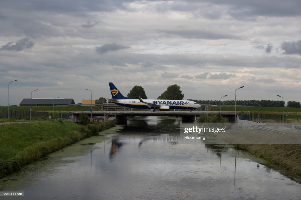 A passenger aircraft operated by Ryanair Holdings Plc crosses a bridge after landing at Schiphol airport in Amsterdam, Netherlands, on Tuesday, Aug. 15, 2017. Delta Air Lines Inc., China Eastern Airlines Corp. and Air France-KLM Group are reaching for their checkbooks to forge a deeper global alliance.