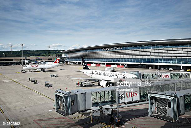 Passenger aircraft operated by Star Alliance and Swiss International Air Lines AG sit parked at Zurich Airport operated by Flughafen Zuerich AG in...