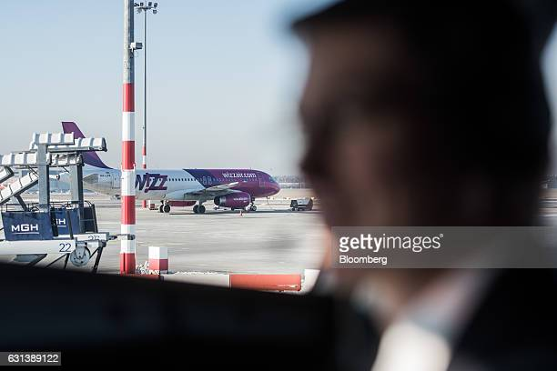 A passenger aircraft operated by Wizz Air Holdings Plc stands parked on the tarmac at Liszt Ferenc airport in Budapest Hungary on Monday Jan 9 2017...
