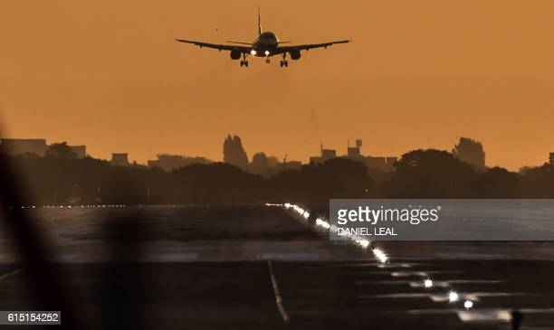 A passenger aircraft prepares to land during sunrise at London Heathrow Airport in west London on October 17 2016 Britain's government is considering...