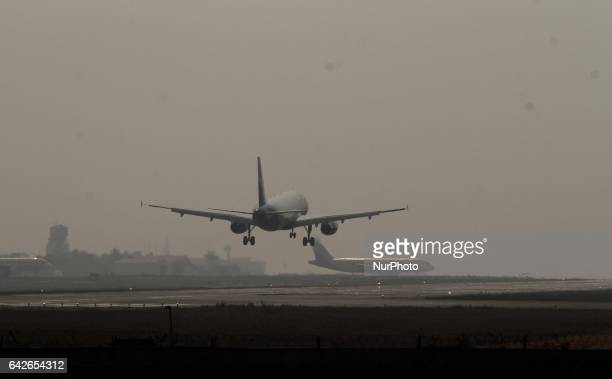 Passenger aircrafts are seen on the run way as they are take up and landing in a foggy morning weather in the Biju Pattnaik International airport in...
