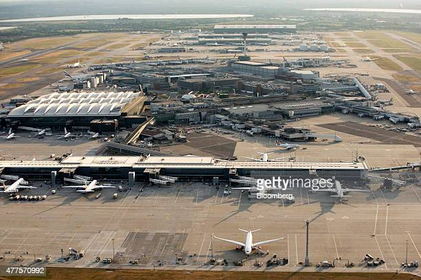 Passenger aircrafts sit on the tarmac at Terminal's 1 and 3 at London Heathrow Airport in this aerial photograph taken over London UK on Tuesday June...