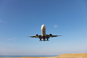 Passenger airplane landing over sea in summer season