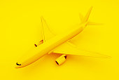 Passenger Airplane, Yellow Background. Isometric Concept. 3d illustration.