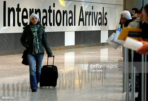 A passenger arrives at the International Arrivals in Terminal 5 on March 27 2008 in London England Terminal 5 opens to the public for its first day...