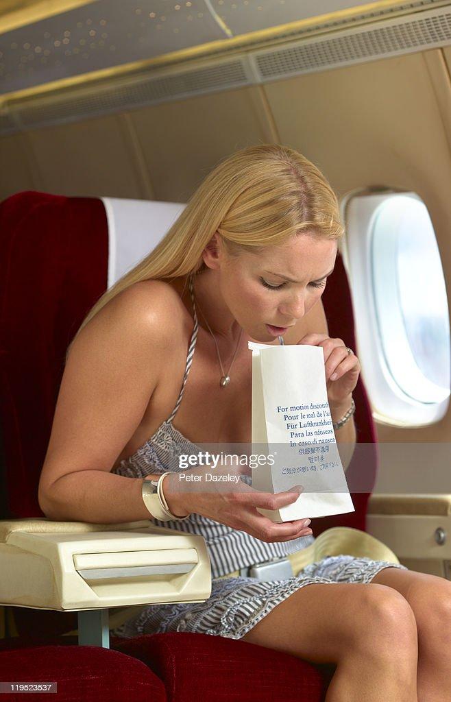 Passenger being sick on plane