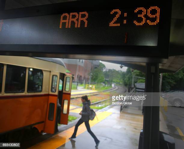 A passenger boards an Ashmontbound trolley at Milton Station in Boston beneath a digital countdown clock on Jun 6 2017 Passengers who rely on the...