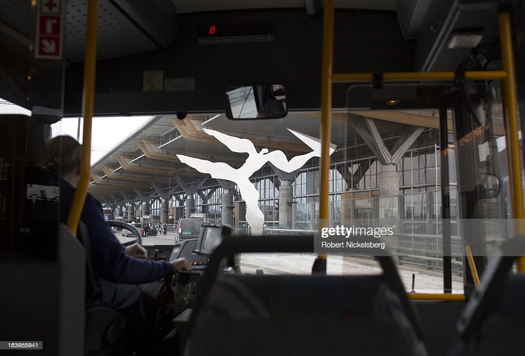 A passenger bus approaches the Oslo Airport Gardermoen March 9, 2013 in Oslo, Norway. A metal sculpture, titled Utkast by Kare Groven, stands at the departure entrance. Gardermoen is the main domestic hub and international airport for Norway.