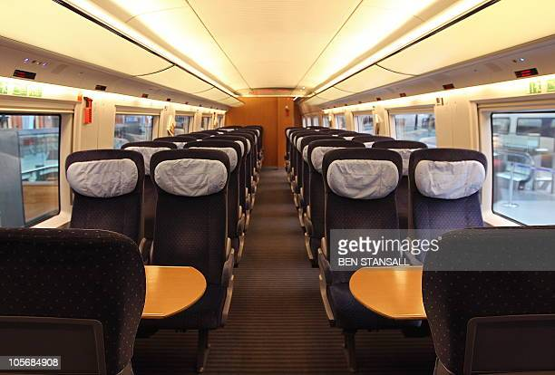 A passenger carriage of an ICE high speed train operated by German rail firm Deutsche Bahn is pictured during a photocall at St Pancas International...