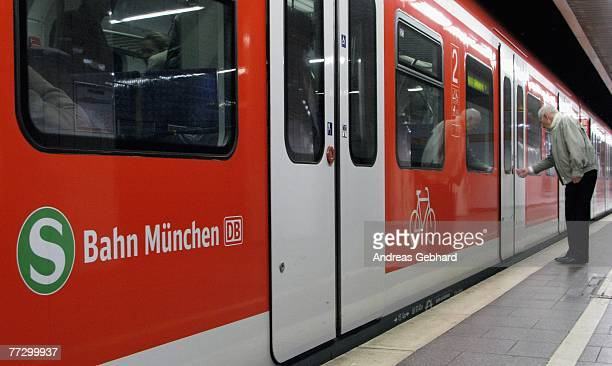 A passenger enters one of the few remaining commuter trains during a daylong strike of train drivers on 12 October 2007 in Munich Germany Many people...